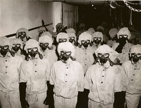 280px-Decontamination_Party_in_Full_Gear-_Nerve_Agents.JPG